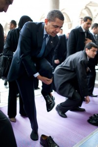 Obama removes his shoes at the Blue Mosque April 7, 2009, in Istanbul.
